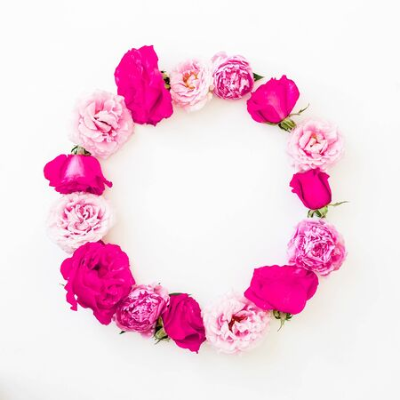 Round frame with pink rose flowers, petals and peonies on white