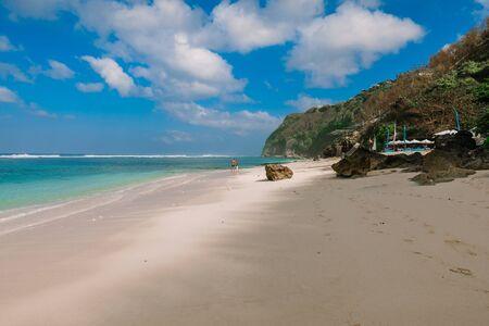 Tropical sandy beach with blue ocean in paradise island