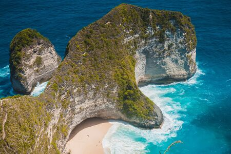 Manta Bay Beach with rocks and blue ocean in Nusa Penida. Popular place for tourism