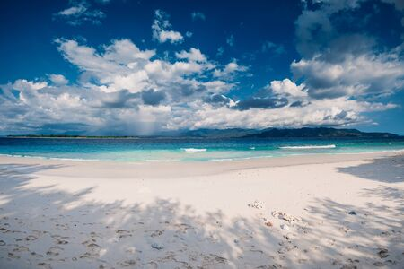 Paradise beach with blue ocean in tropical island