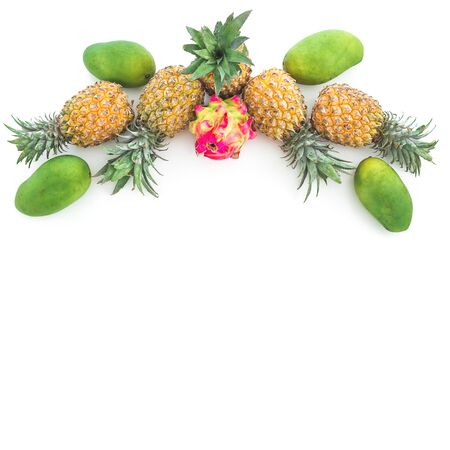Pineapple, mango and dragon fruits on white background. Tropical food. Flat lay, top view.