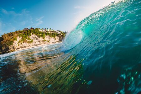 Breaking blue wave. Barrel wave for surfing.