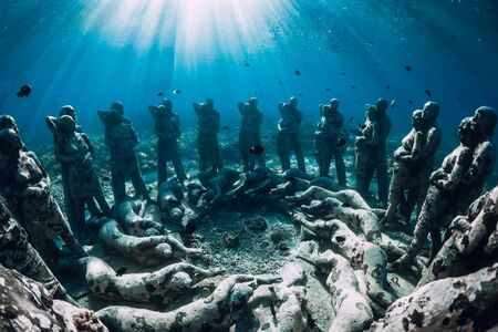 Underwater statues in blue ocean with fish. Underwater tourism in ocean. Stok Fotoğraf