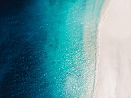 Beautiful tropical beach with turquoise crystal ocean, aerial view.