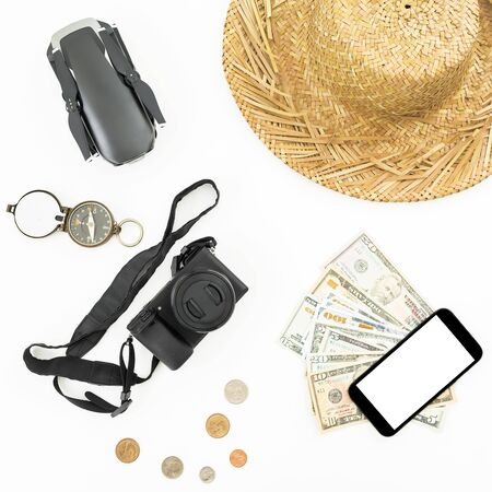 Travel concept with drone, straw hat, photo camera, compass and usa modey on white