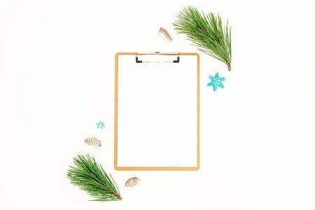 Christmas winter concept with clipboard, evergreen pine branches and cones on white Stock Photo