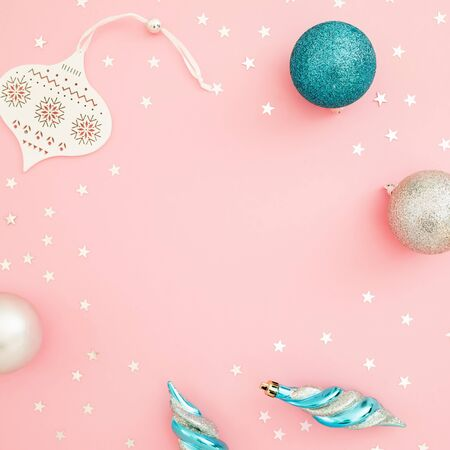 Christmas composition. Decoration and confetti on pink