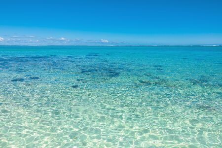 Relaxing tropical scenery - beautiful beach with transparent ocean and blue sky of Mauritius