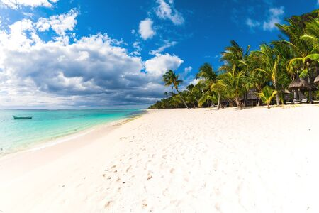 Beautiful view of the resort on Mauritius. Transparent ocean, white sand, palms and blue sky