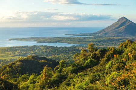 View of the mountain, ocean and Tamarin in the evening. Mauritius.