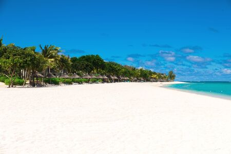 Tropical scenery - beautiful beach with ocean and blue sky