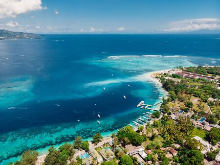 Beautiful tropical island with turquoise ocean, aerial view. Gili islands