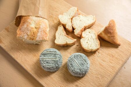 Baguette bread and blue cheese. Close up view