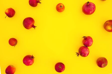 Pomegranate fuits isolated on yellow background. Food background. Flat lay, top view Stok Fotoğraf