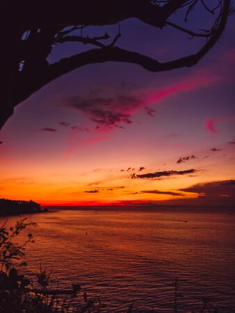 Bright colorful sunset or sunrise with clouds and ocean Banco de Imagens - 132124312