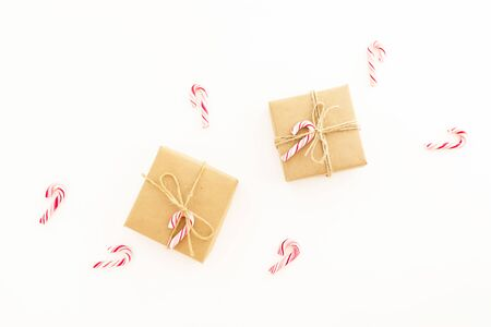 New Year composition. Christmas gifts and candy canes on white background. Flat lay, top view.
