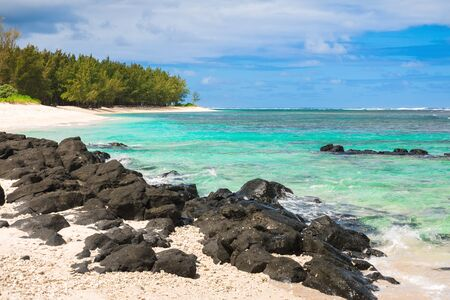 Tropical beach with rocks and transparent ocean in Mauritius island Stok Fotoğraf