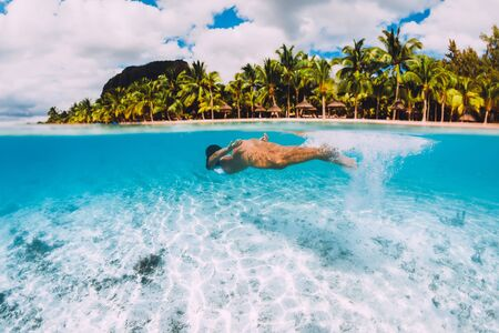 Young attractive woman swimming underwater in transparent blue ocean. Mauritius, Le Morne Stok Fotoğraf