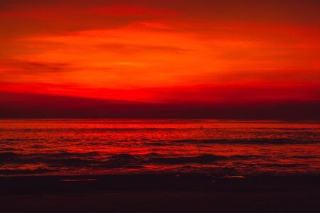 Bright colorful sunset in Bali with ocean