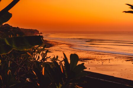 Warm sunset or sunrise with ideal ocean waves in Bali, Impossible beach Stok Fotoğraf
