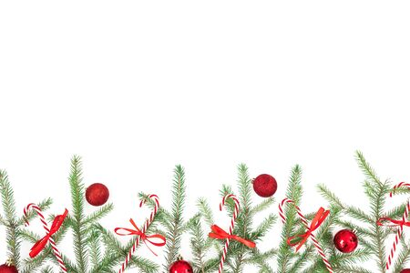 Christmas frame with fir branches and red decoration on white background. Flat lay, top view. Copy space Stok Fotoğraf