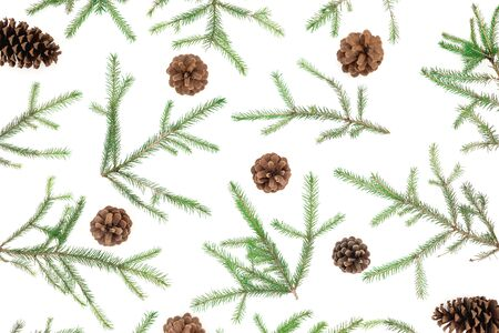 Christmas pattern of fir tree branches and pine cones on white. Flat lay, top view Stok Fotoğraf