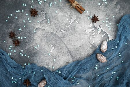Christmas frame made of snowflakes, cinnamon and pine cones on dark background. Flat lay. Top view. Winter composition Stok Fotoğraf