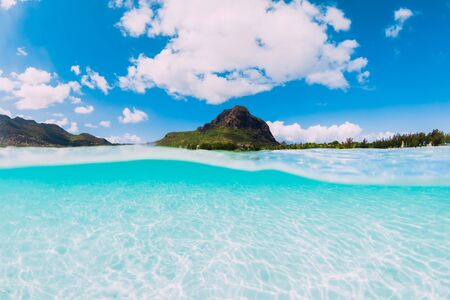 Tropical ocean with white sand and Le Morne mountain in Mauritius.