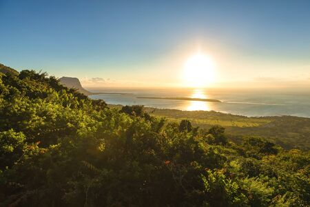 View of mountain of Le Morne Brabant and lagoon at sunset in Mauritius.