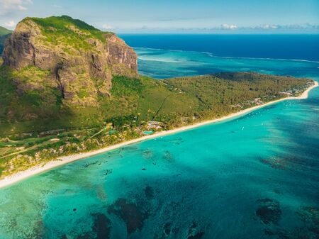 Tropical island with Le Morne mountain, ocean and beach in Mauritius. Aerial view Stock Photo