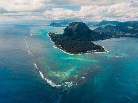 Aerial view of Mauritius island panorama and Le Morne Brabant mountain, blue lagoon and underwater waterfall