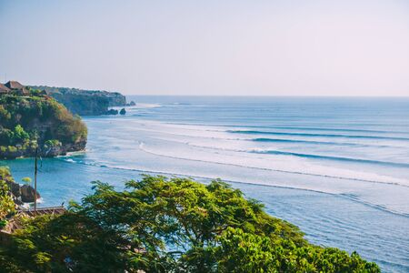Surfing waves for surfing in Bali. Beach and ocean waves in Indonesia