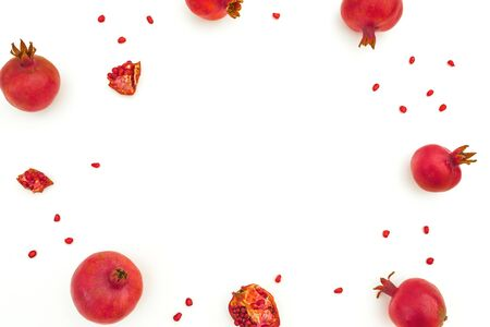 Pomegranate with seeds isolated on white background. Food frame background. Flat lay, top view