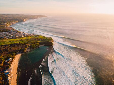 Aerial view of big waves at warm sunset and sandy beach. Ocean wave in Bali 版權商用圖片