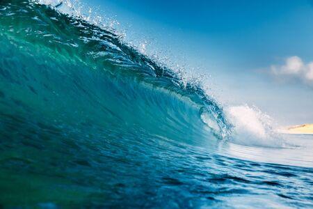 Barrel wave for surfing in ocean. Breaking transparent wave