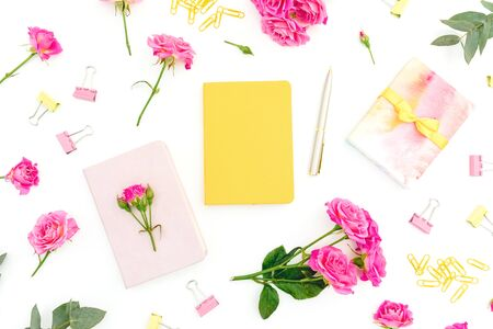 Conceptual composition with notebook, eucalyptus, gift and roses on white background. Flat lay.