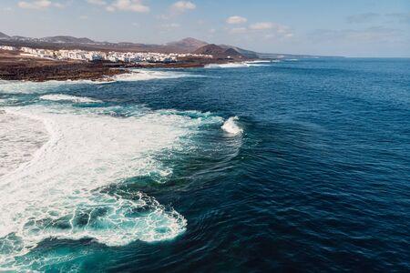 Aerial view of La Santa beach with ocean and village in Lanzarote, Canary islands