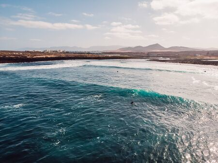 Aerial view of La Santa beach with ocean and waves in Lanzarote, Canary islands