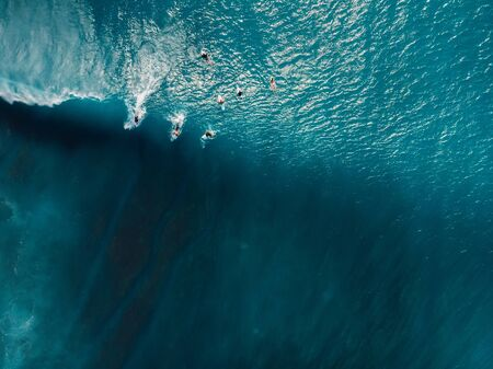 Aerial view of surfing at barrel waves. Blue waves and surfers in ocean Stock Photo