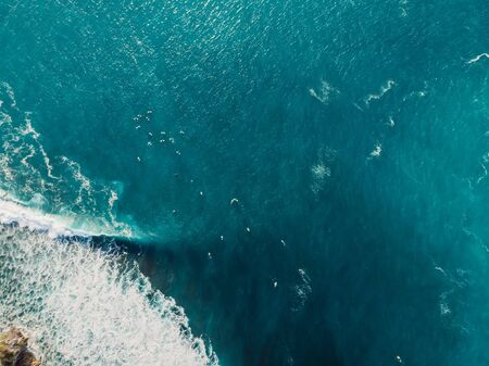 Blue wave with foam in ocean. Aerial view of barrel waves. Top view Stock Photo
