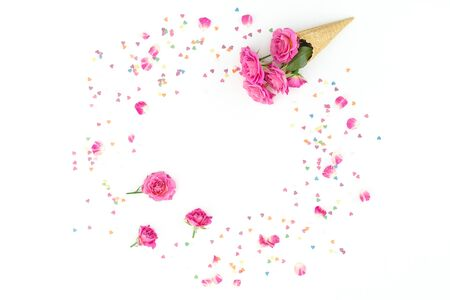 Summer frame composition with pink roses flowers on white background. Flat lay, top view.