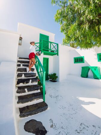Traveller young woman with the old architecture of city in Lanzarote 版權商用圖片