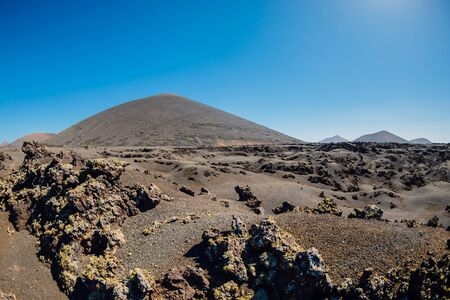Volcanic landscape with volcano, stones and rocks at Lanzarote, Spain. 版權商用圖片