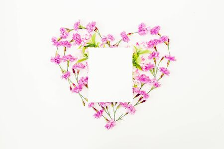 Heart made of pink flowers and paper card isolated on white Stock Photo