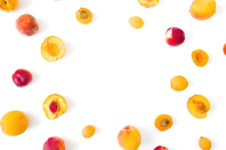 Food frame of ripe peaches with apricotes on white background. Top view. Flat lay Stock Photo