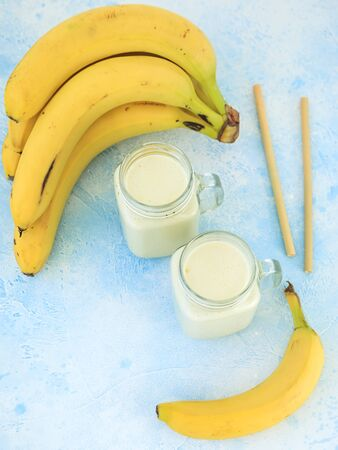 Healthy yogurt or smoothie with banana, vegetarian food, diet and health concept