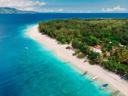 Tropical island with luxury beach and turquoise ocean. Aerial view.
