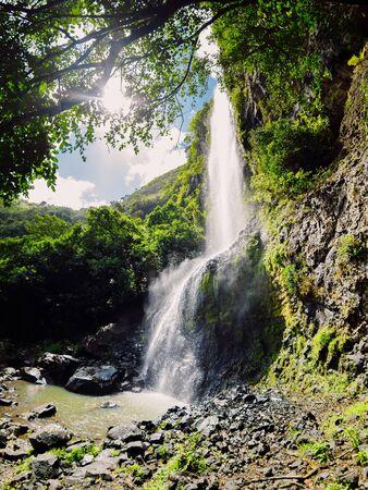 High cascade waterfall in the tropical jungle at Mauritius island