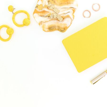 Resin art with yellow diary and pen on white background. Flat lay, top view