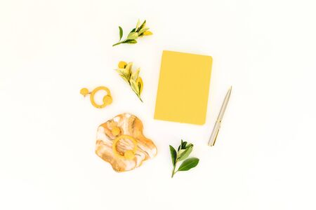 Resin art with yellow diary, pen and leaves on white background. Flat lay, top view Stock Photo